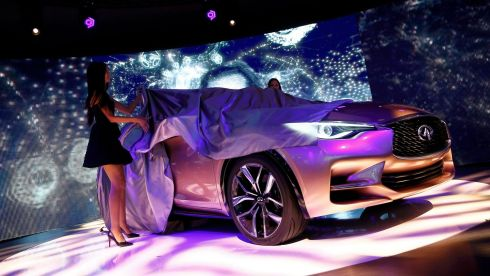 Models unveil an Infiniti Q30 concept car. Photograph: Kai Pfaffenbach/Reuters