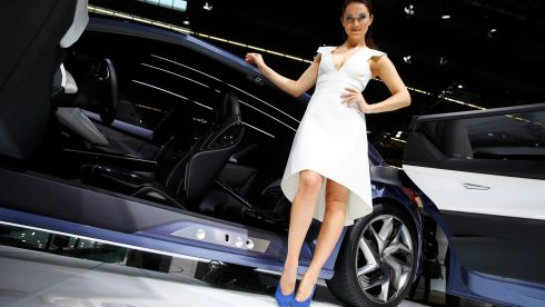 A model poses beside a Nissan 'Friend-Me' concept car. Photograph: Kai Pfaffenbach/Reuters