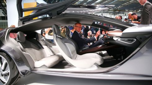 Karl-Thomas Neumann, CEO of Adam Opel AG, sits inside the new Opel Monza concept car during a media preview day at the Frankfurt Motor Show (IAA) September 10, 2013. The world's biggest auto show is open to the public September 14 -22.      REUTERS/Kai Pfaffenbach (GERMANY  - Tags: BUSINESS TRANSPORT)