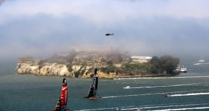 Emirates Team New Zealand races ahead of Oracle Team USA in front of Alcatraz Island during the America's Cup finals in San Francisco, California. Photograph: Jamie Squire/Getty Images.