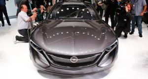 Media surround a Opel Monza concept car at the Frankfurth auto show