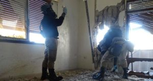 UN chemical weapons experts inspect one of the sites of an alleged chemical attack.