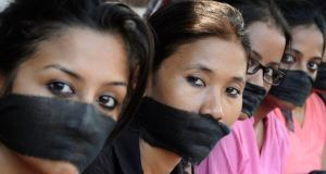 Members of the All Assam Photojournalist Association wear black sashes around their mouths during a protest against the rape of a photo journalist by five men inside an abandoned textile mill in Mumbai, in the northeastern Indian city of Guwahati.