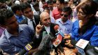 V.K. Anand (centre), defence lawyer for one of the four men who were found guilty of the fatal gang-rape of a young woman on a bus in New Delhi, speaks with the media after the verdict in New Delhi on September 10th, 2013. Photogrpah: Adnan Abidi/Reuters