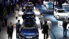 Visitors pass a display of Volkswagen Golf cars at the 65th Frankfurt International Motor Show in Frankfurt, Germany, yesterdat.  Photograph: Jason Alden/Bloomberg