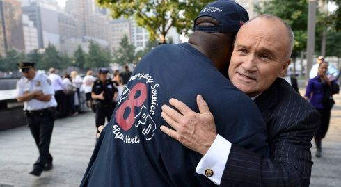 Ray Kelly (R),  New York City Police Department Commissioner, hugs a friend at during ceremonies marking the anniversary of the attacks on the twin towers. Photograph: Reuters