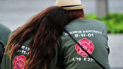 Two people with shirts commemorating New York City Fire Department firefighter Frankie Esposito in New York today. Photograph: Reuters