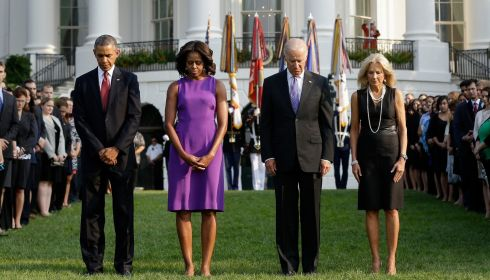 US president Barack Obama, first lady Michelle Obama, vice president Joe Biden, and Jill Biden bow their heads for a moment of silence on the South Lawn of the White House in Washington today.