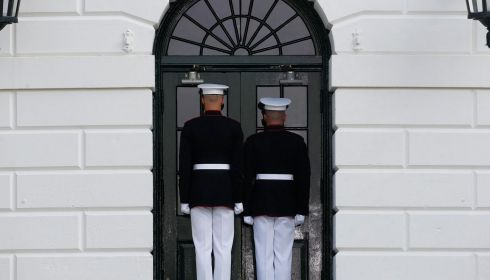 US marines stand at the door before president Barack Obama walks out of the White House today. Photograph: Reuters