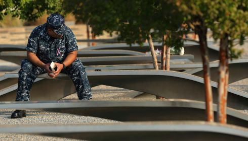 A US sailor sits in the Pentagon 9/11 Memorial before remembrance ceremonies in Washington today. Photograph: Reuters