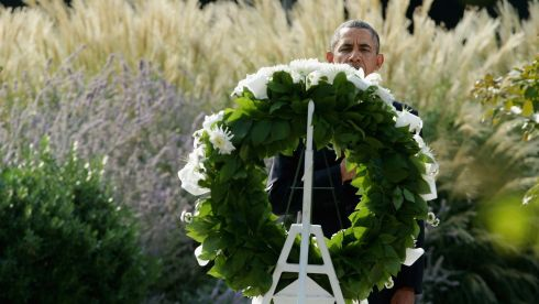 US president Barack Obama stands after laying a wreath during a ceremony in the Pentagon  today. Photograph: Photograph: Chip Somodevilla/Getty Images
