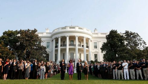 President Barack Obama and members of his staff remember the September 11 victims on the lawn of the White House today. Photograph: Reuters