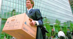 A worker carrying a box out of Lehman Brothers offices in London in September  2008
