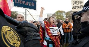 "A demonstrator shouts slogans as hundreds protest outside the Parliament in Reykjavík in October 2010 over the financial crisis – Ireland can learn from the country's ""Wellbeing Watch"".  PHOTOGRAPH: HALLDOR KOLBEINS, Getty Images"