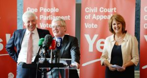 Director of elections and Minister of State Alex White, Tánaiste Eamon Gilmore, and Minister for Social Protection Joan Burton at a Labour Party press conference to call for a Yes vote in the  referendum. Photograph: Alan Betson