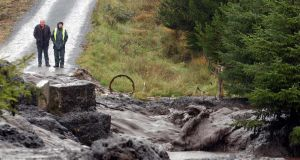 A road is covered by a landslide in Derrybrien, Co.Galway, in 2003 .  Photograph: Joe Shaughnessy