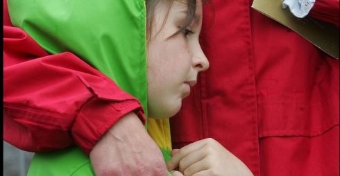 A girl  with her mother during a minute's silence  during a ceremony in Omagh marking the 10th anniversary of the bombing, in 2008. Photograph: Brenda Fitzsimons/The Irish Times