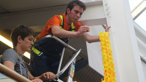 Structural engineer Tom Holmes has just smashed the Guinness World record for the tallest free standing domino tower. Photograph: Guinness Book of Records/PA