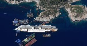 An aerial view shows the Costa Concordia as it lies on its side next to Giglio Island taken from an Italian navy helicopter August 26th 2013.Photograph: Alessandro Bianchi/Reuters