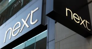 Next posted an  increase in first-half profit but was reliant on a strong performance from its  internet business to offset sales falls in traditional stores