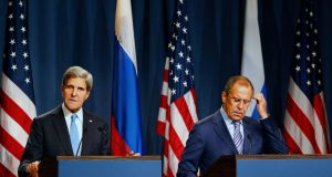 US secretary of state John Kerry and Russian foreign minister Sergei Lavrov at a news conference in Geneva yesterday following their talks on disarming Syria. Photograph: Ruben Sprich/Reuters