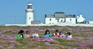 Best Place to Holiday in Ireland: Mo Sheedy, Orla and Hannah Connolly, Mel Sheedy, Mikey, Kate and Niamh Bogenberger at Loop Head Lighthouse. Photograph: Alan Betson