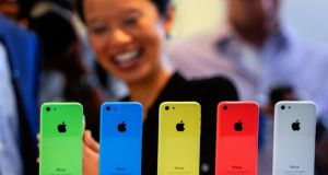 The iPhone 5c is basically last year's model in a colourful skin. Photograph: David Paul Morris/Bloomberg