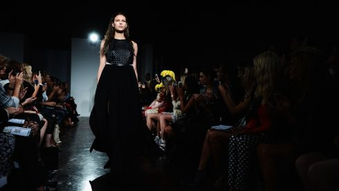 The London fashion elite sit in near darkness. The dress suits the occasion. Photograph: Ian Gavan/Getty Images