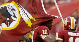 Washington Redskins quarterback Robert Griffin III with the team banner. Photograph: Gary Cameron/Reuters