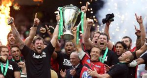 Toulon's Jonny Wilkinson and Joe van Niekerk of Toulon raise the Heineken Cup after their final win this year in Dublin. The competition looks increasingly undre threat. Photograph: David Rogers/Getty Images