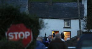 Activity at the scene in Feystown Road, Glenarm, Co Antrim, where two men were found shot dead in a farmhouse. Photograph: Paul Faith/PA Wire