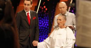 Mrs O'Donnell reacts after having  her hair shaved live on RTE's Late Late show. Photograph: Andres Poveda/The Irish Cancer Society