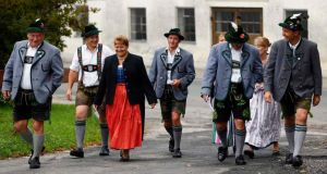 Voters in traditional dress arrive to cast their ballots yesterday in the Bavarian state elections in Haunshofen. Irish commentators' reactions to the euro crisis confirm that we need to get past German stereotypes. Photograph: Reuters/Michael Dalder