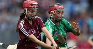 Player of the Match Galway's Orlaith McGrath is challenged by Sarah Carey of Limerick. Photograph: Dan Sheridan/Inpho