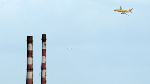 A DHL Boeing 757 flies by the Poolbeg Power Station, at the FlightFest in Dublin today (Sun).  Photograph : Eric Luke / THE IRISH TIMES