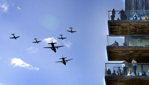 Casa and PC9's of the Irish Air Corps in a six ship formatio fly past an apartment block on Clarion Quay during the IAA Flight Fest , Dublin. Photograph: Brenda Fitzsimons / THE IRISH TIMES