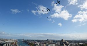 Two Aer Corps Casa escorted by four PC9 aircraft, flying over the river Liffey, at the FlightFest in Dublin today.  Photograph: Eric Luke/The Irish Times