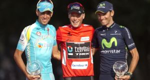 Vuelta a España overall race winner Chris Horner of United States, centre, poses with second-placed Vincenzo Nibali of Italy, left, and third-placed Spaniard Alejandro Valverde on the podium in Madrid. Photograph: Paul White/AP Photo