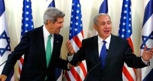 US secretary of state John Kerry shakes hands with Israeli prime minister Binyamin Netanyahu in Jerusalem yesterday. Photograph: Reuters/Larry Downing