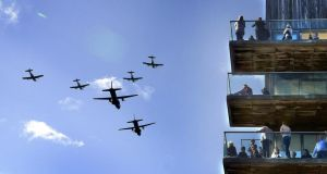 An  Irish Air Corps  formation flying past an apartment block on Clarion Quay in Dublin during  FlightFest. Photograph: Brenda Fitzsimons