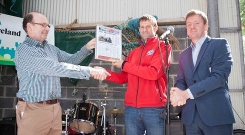 Irish Times Editor Kevin O'Sullivan (left) and Features Editor Conor Goodman (right)  make a presentation to Cillian Murphy, chairman Loop Head Tourism (centre) at a community event in Carrigaholt to celebrate Loop Head winning the Best Place to Holiday in Ireland award. Photograph: Eamon Ward