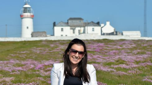 Ailish Connolly, marketing volunteer with the Loop Head Tourism Network, soaks up sun at the lighthouse. Photograph: Alan Betson/The Irish Times