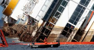 The capsized Costa Concordia rises very slowly towards the upright position today. Photograph: Tony Gentile/Reuters