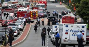 Emergency vehicles and police officers l respond to a shooting at an entrance to the Washington Navy Yard today. Photograph:  Alex Wong/Getty Images