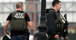 Armed agents stand on the 11th Street Bridge adjacent to the Navy Yard complex where a shooting took place early this morning. Photograph:  Win McNamee/Getty Images
