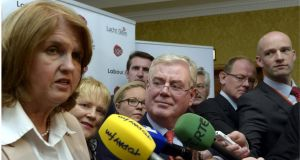 Minister for Social Protection Joan Burton and Tánaiste Eamon Gilmore at the  Labour Party think-in in Enfield, Co Meath, yesterday.  Photograph: Brenda Fitzsimons