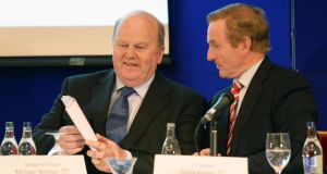 Taoiseach Enda Kenny  and  Minister for Finance Michael Noonan, at the Fine Gael Parliamentary Party conference, at Killenard, Co Laois, yesterday. Photograph: Eric Luke