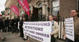 Members of New Beginnings and the Defend Our Homes League protesting outside an auction by Allsop Space  of 74 lots of property. Photograph: Alan Betson