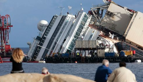 "The Costa Concordia, off the coast of Giglio, Italy, ahead of a ""parbuckling"" operation to right the vessel before it is towed away for scrap. The lengthy operation is a colossal coming-together of engineering effort. Photograph: Tony Gentile/Reuters"