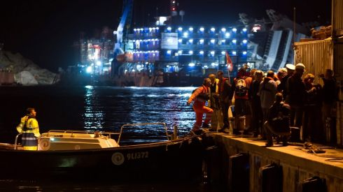 Workers head for a salvage operation they'll never forget. Photograph: Marco Secchi/Getty Images